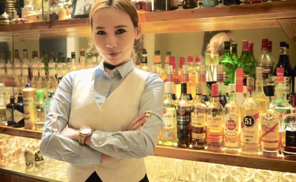 Moe stands behind her tiny bar in Shanghai, where there are only eight seats and reservations are a must.