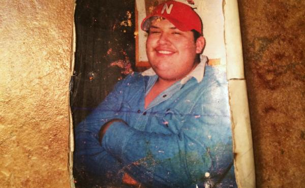 """Sabas Sanchez Jr. was better known among his neighbors in Madison, Neb., as """"Gordo"""" — Spanish for chubby. He also had an oversized personality. His father keeps this tattered photo in his wallet."""
