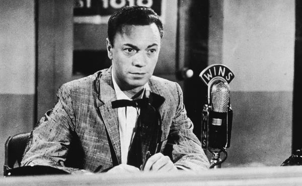 "Radio DJ Alan Freed in the 1950s. Freed's pioneering career as a champion of rock and roll was marred by the revelation that he'd accepted ""payola"" — money from labels to play certain records."