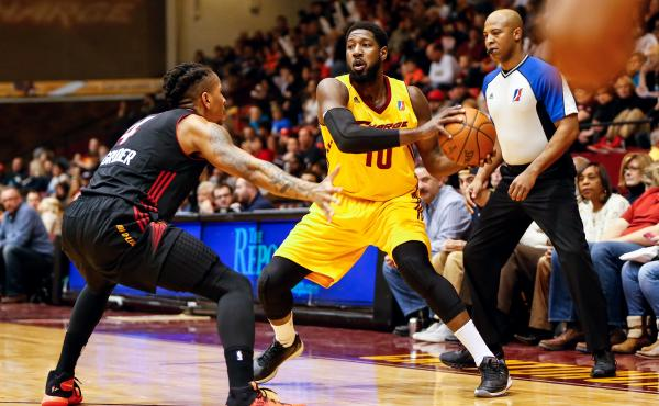 John Holland, No. 10 of the D-League's Canton Charge, looks to pass the ball against the Sioux Falls Skyforce at Canton Memorial Civic Center on Jan. 23, in Canton, Ohio. The 19 teams of the D-League — the NBA's development league — crisscross the cou