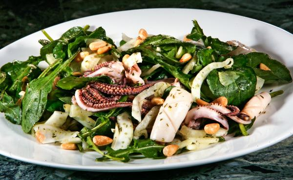 A squid salad in Los Angeles. In California, squid is an economic driver of the seafood industry. But most of this squid is frozen and exported overseas to China to be processed and distributed across the globe.