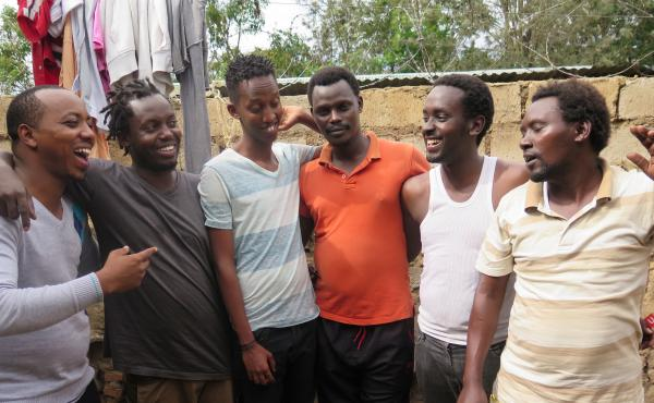 The members of Melodika live in a group house together in Kigali, Rwanda. Percussionist Omer Nzoyisaba is far left, with singer Christian Ninteretse third from the left.