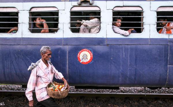 Train journeys in India were once defined by food, brought by passengers from their homes and purchased from vendors like this one. Passengers shared food with each other, exchanging stories and family  histories, and sometimes striking new friendships th