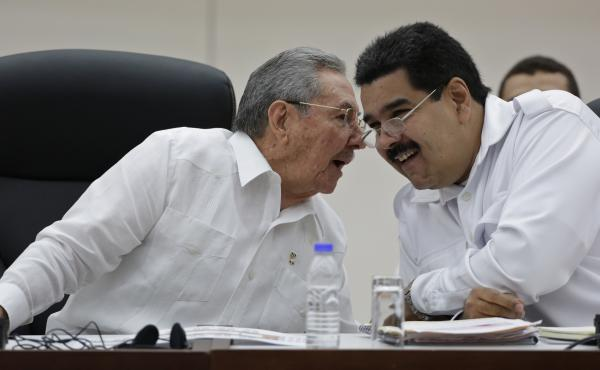 Cuban President Raul Castro (left) talks to his Venezuelan counterpart Nicolas Maduro at a summit in Havana on Oct. 20. The two countries are close allies that have been highly critical of the U.S. But with the U.S. and Cuba now planning closer ties, Cuba