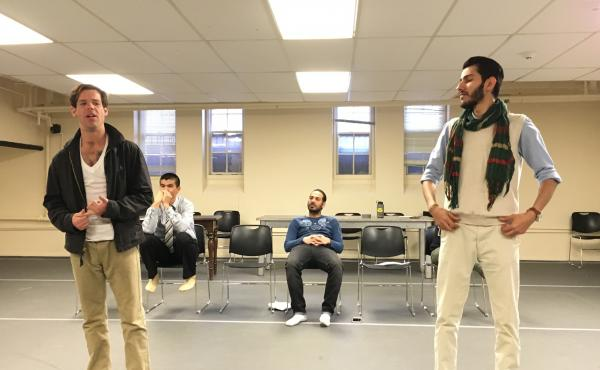 """Former Marine Tom Burke (L) and Maher Mahmood (R) and Iraqi refugee rehearse for the play """"Voices From Teh Long War"""" at the Yale Cabaret building on the Yale campus."""