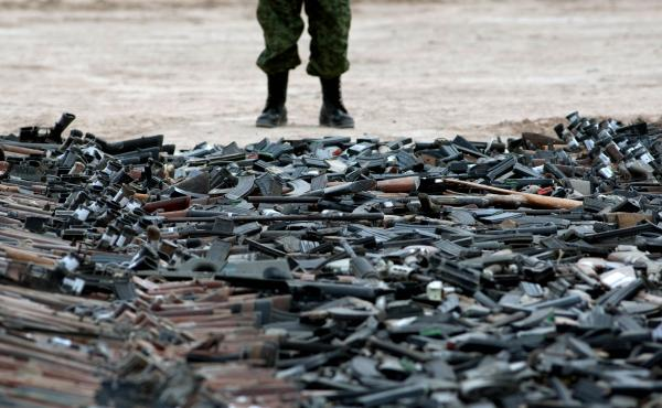A new government report details the problems agencies face in fighting weapons trafficking. Here, thousands of guns lie on the ground before being destroyed in Ciudad Juarez, Mexico, in 2012.