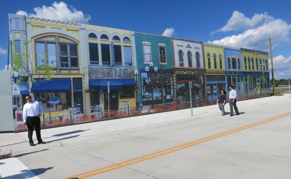 """Mcity's """"downtown"""" is actually a silk-screen recreation of a street in Ann Arbor, Mich. Researchers have built the small fake city at the University of Michigan as a testing ground for autonomous vehicles."""