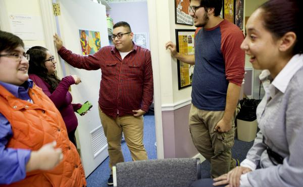 Lacey Williams (from left), Mary Espinosa, Jaime Villegas, Armando Cruz Martinez and Elisa Benitez talk inside the offices of the Latin American Coalition in Charlotte, N.C. According to a 2011 Pew Hispanic report, the median age of Latinos in North Carol