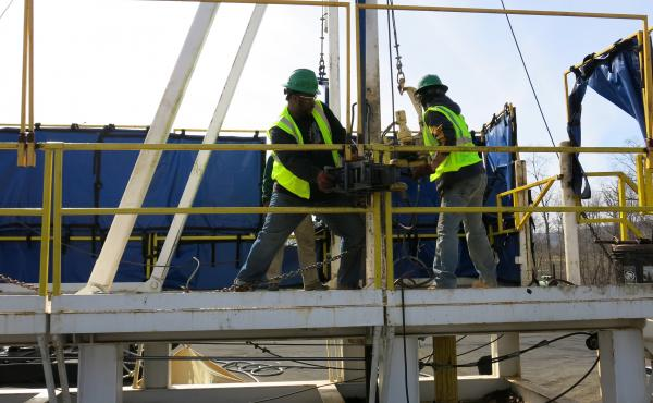 "Students at the Pennsylvania College of Technology are learning a technique called ""tripping pipe,"" moving a pipe from a stack into a horizontal position and lowering it down into a well.  The students train on a practice drilling rig to learn how to be r"