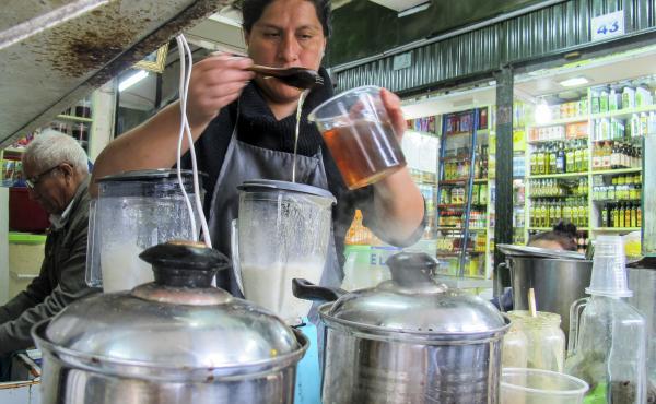 Jackie Rodriguez Peña prepares a frog smoothie at her stand at the Mercado de las Brujas in Lima, Peru.