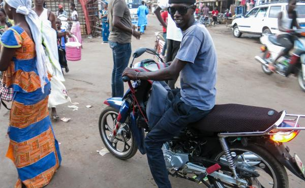 Assane Thiobane, 28, a motorbike taxi driver in Tambacounda, eastern Senegal, is saving up to leave for Europe, where he hopes to earn more money for himself and his family. If you die along the way, he says, that's your destiny.