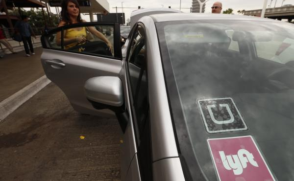 A car with Uber and Lyft stickers at Los Angeles International Airport. Uber dominates the fast growing ride hailing business. But Lyft is waging a spirited battle to keep up.