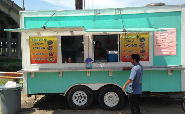 Taqueria La Delicia is a lonchera, or food truck, that parks near a Lowe's Home Improvement store in New Orleans. The owner is Honduran, and so are many of the day laborers who eat there.