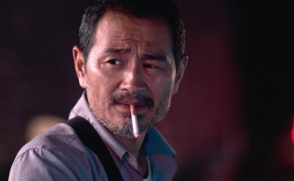 Chen Gang as a taxi driver in Old Stone, director Johnny Ma's debut feature.