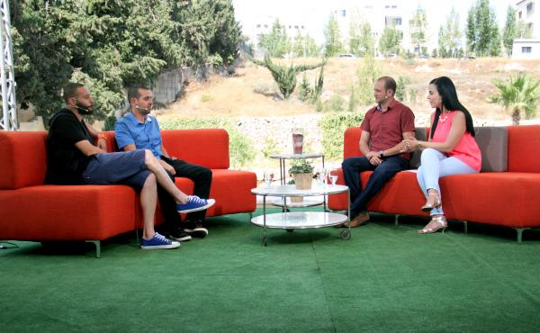 Doraid Liddawi and his co-host, Afaf Shini, interview Palestinian Arab rappers and citizens of Israel on the makeshift Ramallah set of Palestine 48's morning show.
