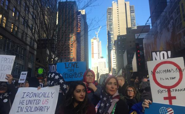 "Amal Bajes, sporting a printed American flag hijab, was at the ""I Am Muslim Too"" rally in New York City's Times Square with her daughter on Sunday."