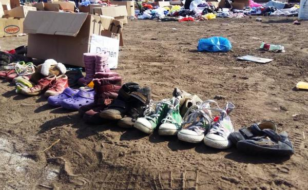 Hungarians line up tiny shoes to donate to refugee kids on the run, on Hungary-Serbia border