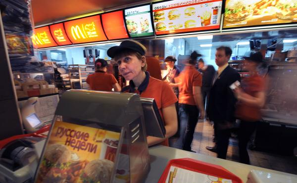 Employees serve clients in a McDonald's restaurant on Pushkin square in Moscow on Feb. 1, 2010. The restaurant was the first in Russia and opened on Jan. 31, 1990.