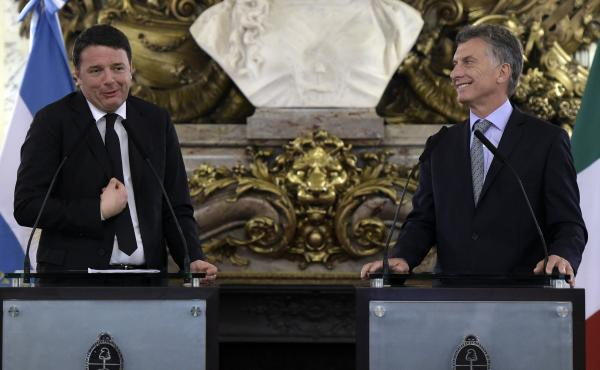 Italian Prime Minister Matteo Renzi (left) talks to the media alongside Argentine President Mauricio Macri in Buenos Aires on Tuesday. Renzi has inspired some mockery in the Italian press for reciting a poem he claimed was by Jorge Luis Borges, which, wel