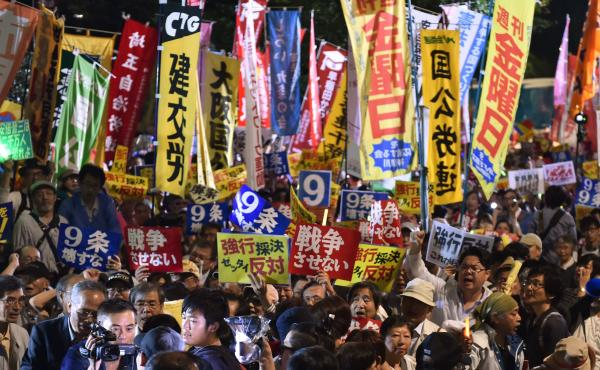 Demonstrators rally against Japanese Prime Minister Shinzo Abe's controversial security bills in front of the National Diet in Tokyo in September. The bills, which passed, will allow Japan to send its troops overseas for the first time since World War II.