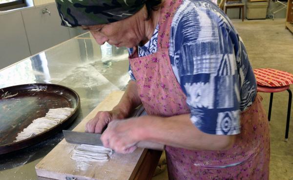 Reiko Tsuzuki, 70, makes buckwheat soba noodles by hand in her restaurant kitchen in the Japanese island of Shikoku.