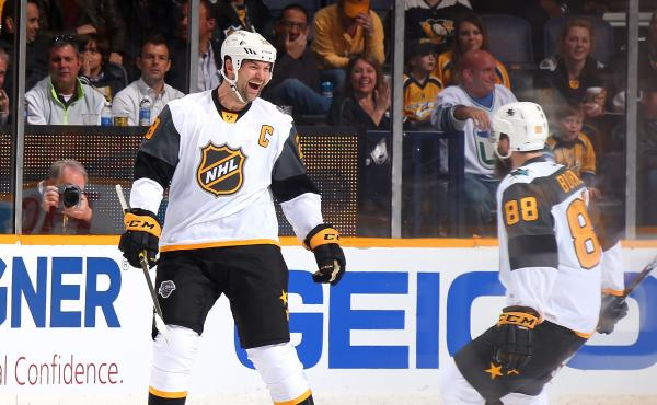 John Scott celebrates scoring a goal in a 3-on-3 tournament at the All-Star game Sunday, along with Brent Burns of the San Jose Sharks.