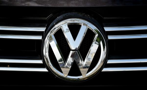Volkswagen logos are visible at a dealership in Los Angeles on June 28. Volkswagen has agreed to pay out $14.7 billion in a settlement with U.S. authorities and car owners over its emissions-test-cheating diesel-powered cars. The settlement was approved o
