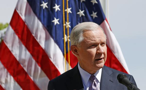 Attorney General Jeff Sessions speaks at a news conference after touring the U.S.-Mexico border on April 11. The Justice Department is warning so-called sanctuary cities that they must prove they are complying with federal immigration laws or risk funding