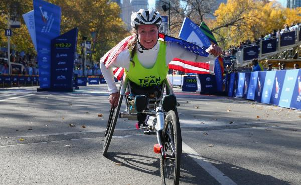 Tatyana McFadden of the United States celebrates winning the Professional Women's Wheelchair Division for the fourth consecutive time during the 2016 New York City Marathon.