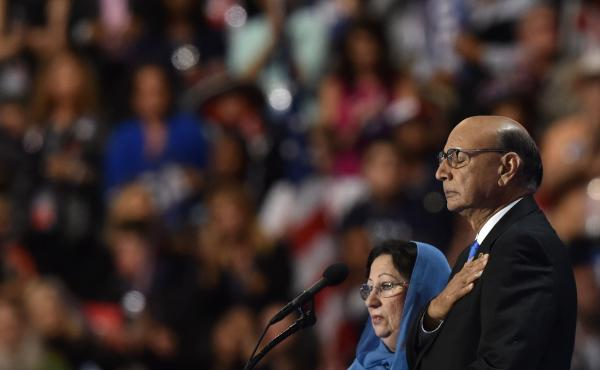 Khizr Khan, father of Humayun S. M. Khan, who was killed while serving in Iraq with the U.S. Army, stands on stage with his wife during the Democratic National Convention on July 28 in Philadelphia.