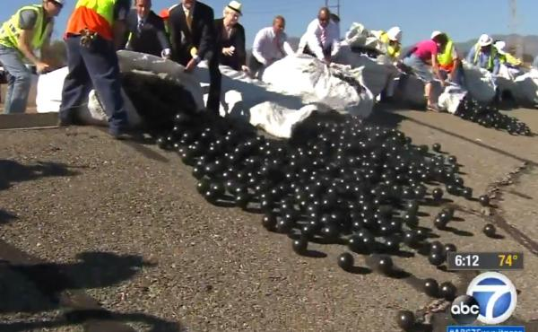 In this photo, obtained from ABC7 News in Los Angeles, the shade balls are released into the reservoir.