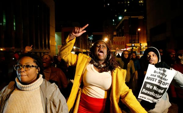 Protesters march through the streets after a mistrial was declared in the trial of Baltimore police Officer William G. Porter on Wednesday.