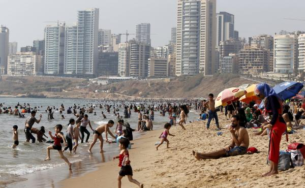 Lebanese gather at a public beach in Beirut on Aug. 2. Lax governance has allowed developers to turn much of the coastline into private clubs, leaving a dwindling number of public beaches along the Mediterranean.