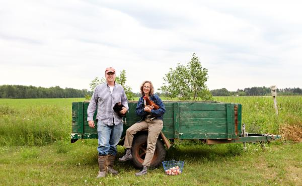 Jason and Lucie Amundsen on their farm in in Wrenshall, Minn.