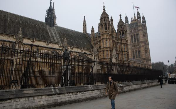 With Parliament Square reopened after Wednesday's attack, people walk past the Houses of Parliament, with the Union Jack flag flying at half-staff in London.