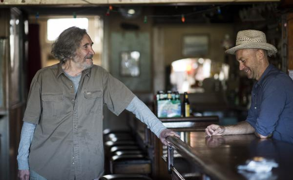 Bartender Sunny Balzano (left) transformed a longshoremen's bar in Red Hook, Brooklyn into a local institution. He's pictured above with Tim Sultan, who recounts Balzano's story in Sunny's Nights.