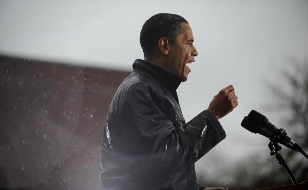Then-Senator Barack Obama speaks as rain falls during a rally at Widener University in Chester, Penn. in October 2008.