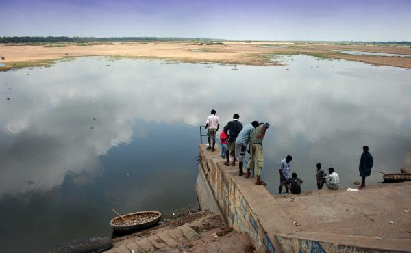 People gather at bank of the Cauvery River in the state of Tamil Nadu.