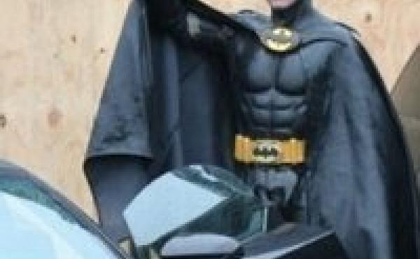 Lenny B. Robinson dressed as Batman to cheer up sick kids.