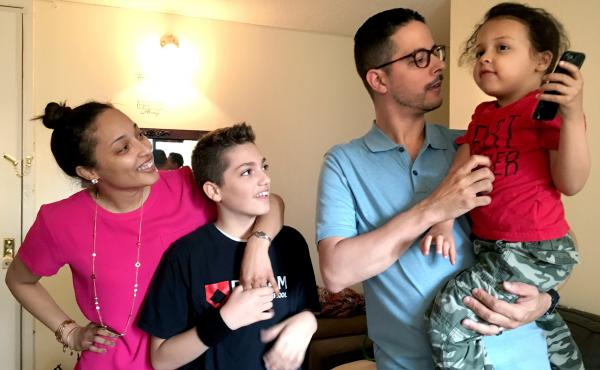 Melanie Vega (left) with her husband Daniel, and their two children, at their home in New York.