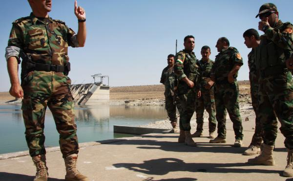 Brig. Gen. Mohammad Ali Mughdeed talks to the men he commands to protect the Mosul dam, a critical piece of infrastructure that supplies water and electricity. The dam is now close to the front line with the militants of the Islamic State in Iraq.