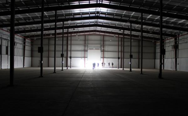 The interior of one of several large warehouses at Kandahar Airfield. Because the U.S. military can't use them, they'll likely pass to the Afghan government.