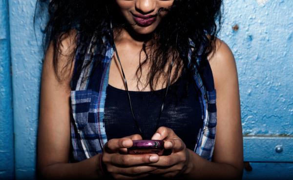 About one-third of black and Hispanic teens say they're online just about all the time, compared with about 1 in 5 whites, a new study says.
