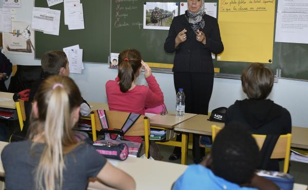 Latifa Ibn Ziaten, shown here speaking to French elementary schoolchildren in March, started an organization to prevent radicalization after her son, a French soldier, was killed by an Islamist gunman in March 2012.