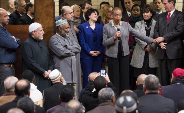 Democratic members of Congress address the worshipers at the Dar al-Hijrah Islamic Center after Friday prayers on Dec. 4 in Falls Church, Va.