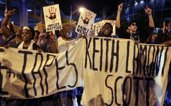 "People march in Charlotte, N.C., on Sept. 23 to protest the fatal police shooting of Keith Lamont Scott. The Mecklenburg County district attorney said Wednesday he was ""entirely convinced"" that the officer who shot Scott ""was lawful in using deadly force."