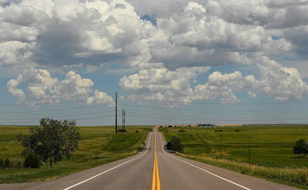 A desolate Highway 36 runs past what is now a ghost town on the eastern plains in Cabin Creek, Colorado.