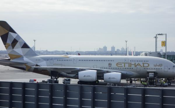 An Etihad Airways jet is parked at JFK International Airport in New York on Tuesday. Passengers traveling to the United States from 10 airports in eight Muslim-majority countries will have to check most electronics. The ban will affect flights on Royal Jo