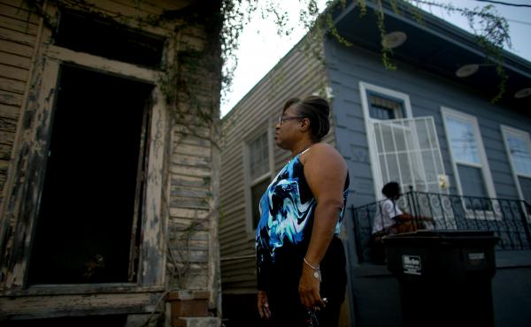 Angela Chalk looks at a home in New Orleans' 7th Ward that hasn't been touched since Hurricane Katrina. Chalk, the vice president of the 7th Ward neighborhood association, spends some of her free time tracking down and reporting dilapidated and abandoned