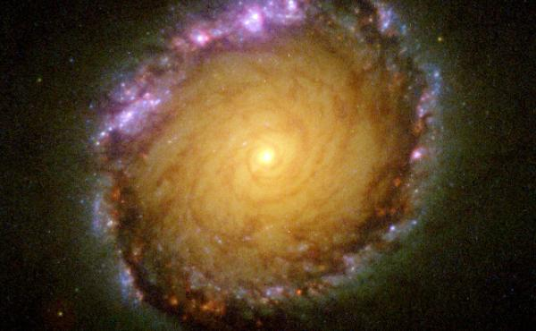 A new study shows energy output from 200,000 galaxies is half what it was billions of years ago. It's further evidence the universe is slowly declining. This undated NASA Hubble Space Telescope image shows the spiral galaxy NGC 1512 captured in all wavele